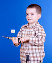 Cute young boy holding screw-driver Royalty Free Stock Image