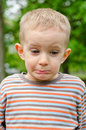 Cute young boy pulling a funny expression Royalty Free Stock Photo