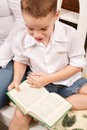 Cute Young Boy Reading His Book Stock Photo