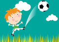 Cute young boy soccer outfit jumping kicking ball Royalty Free Stock Images