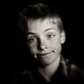 Cute young boy with a whimsical wry expression Royalty Free Stock Photo