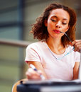 Cute young business woman making a note Royalty Free Stock Images