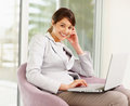 Cute young business woman using a laptop Stock Image