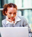 Cute young business woman working on a laptop Royalty Free Stock Photos