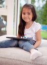 Cute Young Child with Digital Tablet Royalty Free Stock Image