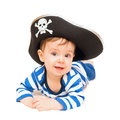 Cute young child dressed as pirate over white isolated on the kid wearing in costume Stock Photo
