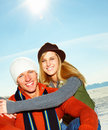 Cute young couple embracing out on the snow Royalty Free Stock Photography