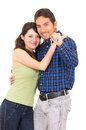 Cute young couple happy hugging holding key concept of new house car isolated on white Royalty Free Stock Photo
