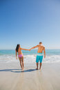 Cute young couple having holidays together on the beach Stock Image