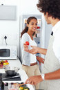 Cute young couple preparing food together at home Royalty Free Stock Photography