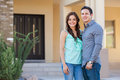 Cute young couple at their new home happy latin in front of house Royalty Free Stock Image