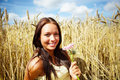 Cute young female at a crop field on a sunny day Royalty Free Stock Image