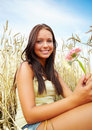 Cute young female with flower at a crop field Royalty Free Stock Images