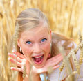 Cute young female shouting at a field Royalty Free Stock Image