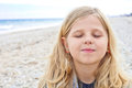 Cute young girl at the beach closeup portrait of a Stock Photo