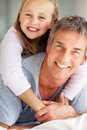 Cute young girl and father in a playful mood Royalty Free Stock Photo