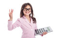 Cute young girl with glasses and calculator counting a holding up three fingers isolated on white background Royalty Free Stock Images
