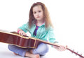 Cute young girl holding guitar knees Royalty Free Stock Photo