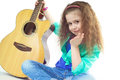 Cute young girl holding guitar sending kiss Stock Photo