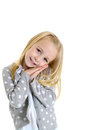 Cute young girl with innocent gesture her hands folded adorable against cheeks Stock Photography