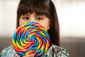 Cute young girl with lollipop Royalty Free Stock Image