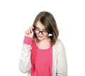 Cute young girl looking over his glasses to view. Royalty Free Stock Photo