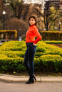 Cute young girl in orange jacket nice vibrant walking autumn city Stock Photo