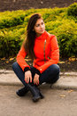Cute young girl in orange jacket nice vibrant walking autumn city Stock Images