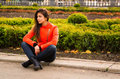 Cute young girl in orange jacket nice vibrant walking autumn city Royalty Free Stock Photography