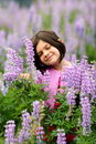 Cute Young Girl in Patch of Purple Wild Flowers Royalty Free Stock Photos