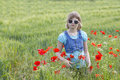 Cute young girl in poppy field Royalty Free Stock Photo