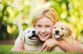 Cute young girl with puppies adorable playing and hugging Royalty Free Stock Images