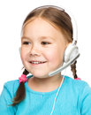 Cute young girl is working as an operator at helpline talking with customer using headset isolated over white Stock Photos