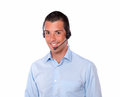 Cute young guy speaking with earphone portrait of a while smiling at you on isolated studio Royalty Free Stock Image