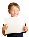 Cute young happy preschooler boy holding up sign Royalty Free Stock Photo
