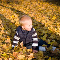 Cute young kid playing outdoors. Royalty Free Stock Photo