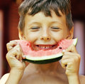 Cute young little boy with watermelon crustes smiling Royalty Free Stock Photo