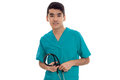 Cute young man doctor in blue uniform with stethoscop in his hands posing and looking at the camera isolated on white Royalty Free Stock Photo
