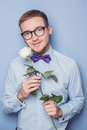 Cute young men with flower. Date, birthday, Valentine