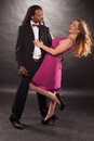 Cute young mixed couple dancing multiracial with a dreadlock african american men and blond women Stock Photos