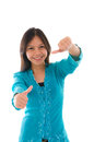 Cute young muslim girl giving a thumb up sign over white backgro background focus on photo Stock Photography