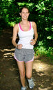 Cute young runner on wooded trail Royalty Free Stock Photography