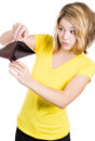 Cute young surprised, unhappy, puzzled woman, girl holding an empty wallet