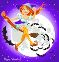 Cute young witch on a broomstick in the night sky Royalty Free Stock Image
