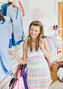 Cute young woman choosing clothes in a shop Royalty Free Stock Photos