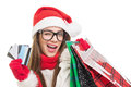 Cute young woman christmas shopping caucasian brunette holding credit cards and bags wearing winter clothes black nerd glasses and Royalty Free Stock Image