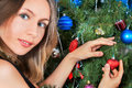 Cute young woman decorating christmas tree new year Royalty Free Stock Image