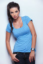 Cute young woman with hands in pockets looking at the camera Royalty Free Stock Photo