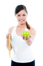 Cute Young Woman Holding Apple And Measuring Tape Royalty Free Stock Photos