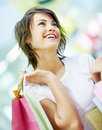Cute young woman holding shopping bags Stock Photography